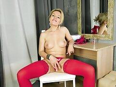 Horny blonde chick in high heels enjoys pleasuring her wet pussy