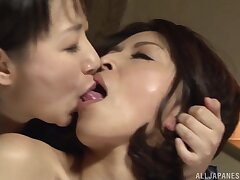 Closeup dusting of two Japanese babes having passionate word-of-mouth sex