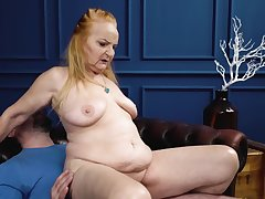Red-haired granny sucks phallus and gets screwed hard