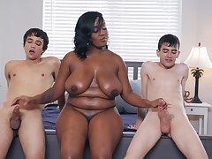 Chubby buxom ebony MILF Layton Benton takes a handful of big white dicks