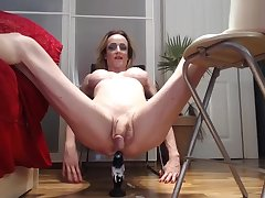 german light-complexioned milf shemale dildoing her asshole