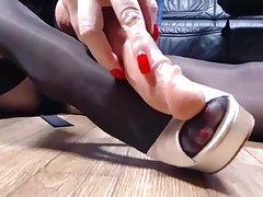 Black pantyhose red nails high heels shoejob