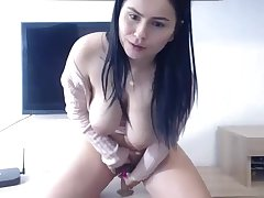 Hot beamy milf rides dildo be beneficial to cum on cam