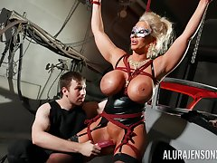 Bound horseshit slut Alura Jenson is toyed with by a stranger nearby a dungeon