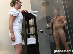 Old woman with high sex drive enjoys watching young tramp taking a shower forwards having sex