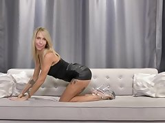 Charismatic blonde babe with tattoos and nice set of tits is often masturbating on the couch